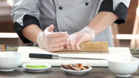 Hands making sushi bamboo mat chef making japanese food Live Action