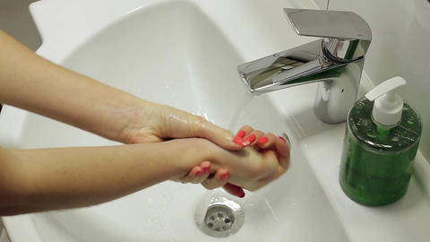 Girl washes her hands with soap hand hygiene Live Action