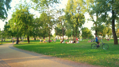 Blurred image of people picnic in the park Live Action