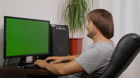 young man videoconferencing distance chatting by web cam and laughing using Live Action