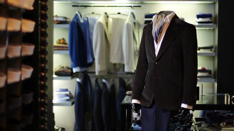 Interior of mens clothing store mens suits Live Action