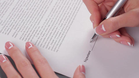 Business woman signs a agreement woman signs a document Live Action