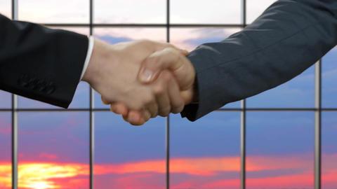 Businessman shake hands at sunset men shaking hands in office Live Action