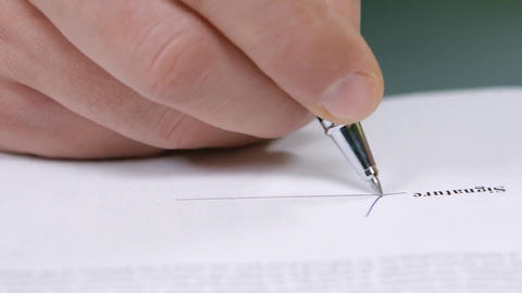 Businessman signs a document business deal signing of the contract Live Action