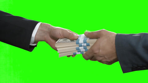 Male hands pass dollar bundles key handover on tenderloin background Live Action