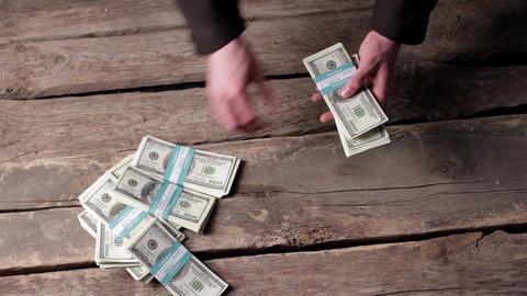 Male hands taking dollar bundles mans hands pick up cash Live Action