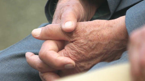 Close up hands of old man caucasian senior male folded hands Live Action