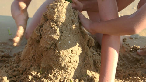 Kids building a sand structure children playing outdoor Live Action
