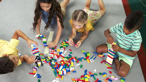 Kids playing with block toys top view group of children playing Live Action