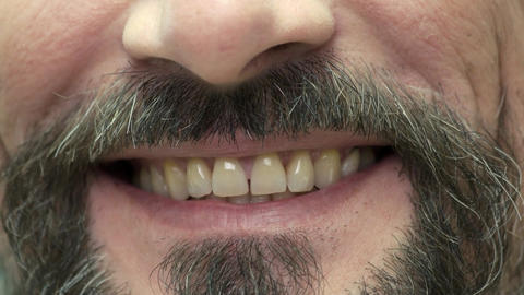 Smile of a bearded man smiling mouth close up Live Action