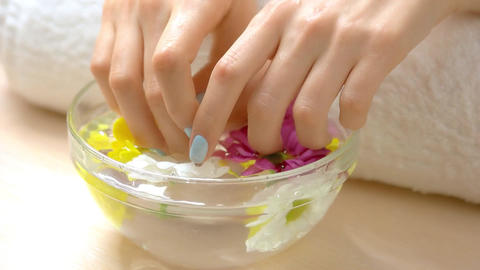 Well groomed hands receiving spa treatment beautiful female hands Live Action