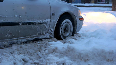 Car stalled in the snow close up of car wheel stuck in snow Live Action