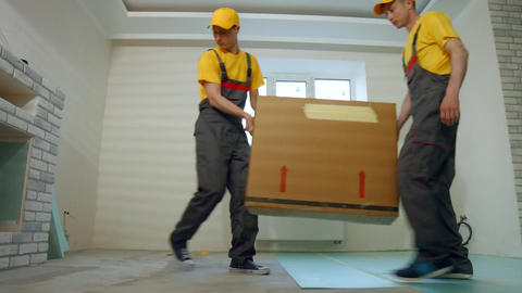 Courier delivery service loaders deliver household appliances Live Action