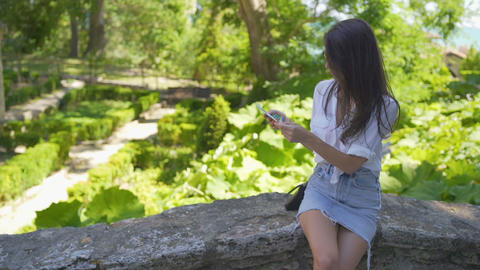 Tourist woman holding travelers map and planning her vacation. Traveller woman Live Action