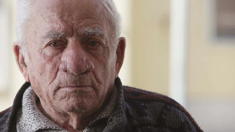depressed old man looks to the camera Footage
