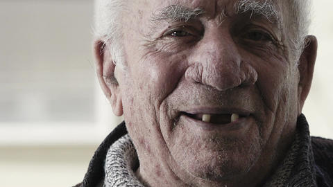sincere laugh: pensioner smiles to the camera Footage