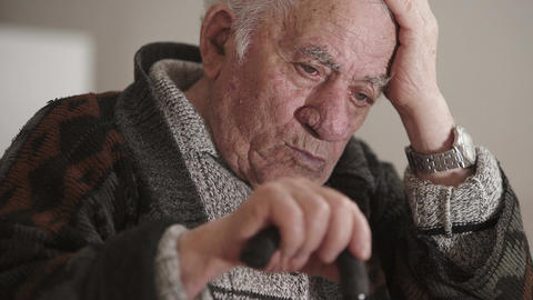 thoughtful, worried senior keep his head with the hand Footage