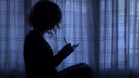 lonely young woman writes an entry in her secret diary Footage