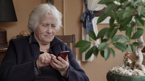 Grandmother texting message on smartphone Footage