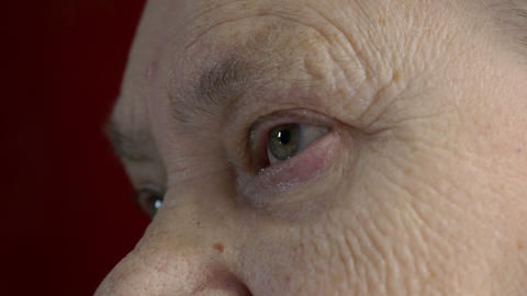 old woman with wrinkled and corrugated face, detail, eye opened Footage