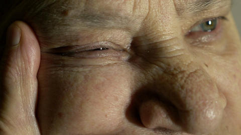 expressive glance of an old wrinkled faced woman, eyes opened Footage