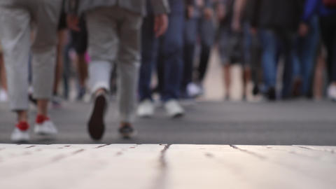 Closeup view of human feet people walking on crowded street in slow motion Live Action