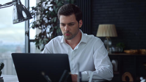 Businessman using laptop computer in office.Employee typing on computer keyboard Live Action