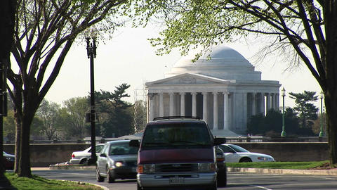 Traffic passes in front of the Jefferson Memorial building Footage