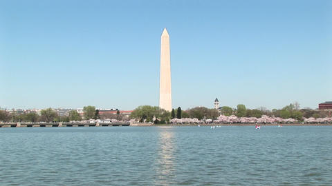 The Washington Monument reflects across a shimmering body... Stock Video Footage