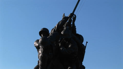 The camera slowly pans up the Iwo Jima Marine Corps Memorial statue Footage