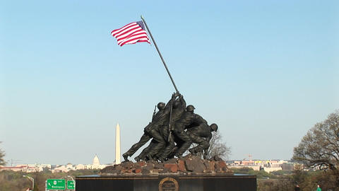 The Iwo Jima Marine Corps Memorial stands tall with the Washington Monument faintly in the backgroun Footage