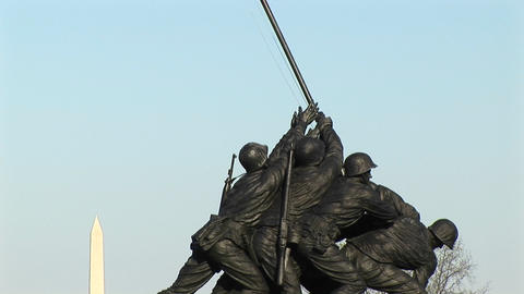 The Iwo Jima Marine Corps Memorial proudly holds up an American flag Footage