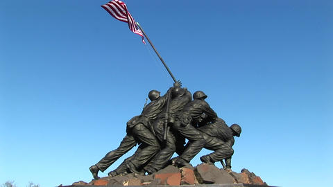 An American flag waves with the breeze at the top of the Iwo Jima Marine Corps Memorial in Washingto Footage