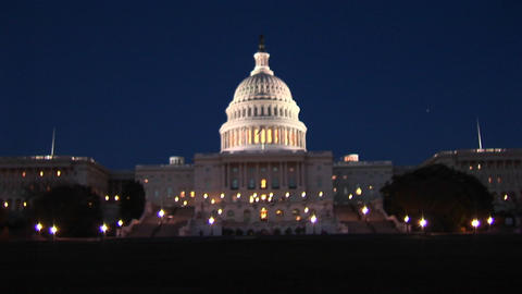 The camera slowly zooms-in on the Capitol Building at night Footage