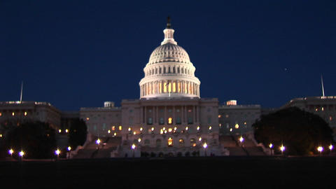 The camera slowly zooms-in on the Capitol Building at night Stock Video Footage
