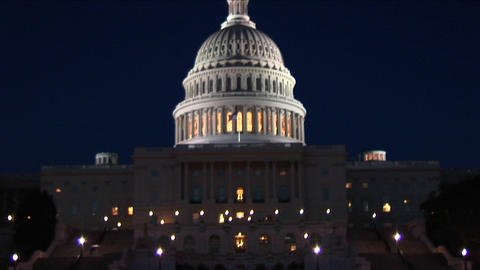 The camera slowly pans up the Capitol Building at night Footage