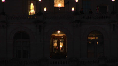 The camera slowly pans up the Capitol Building at night Stock Video Footage