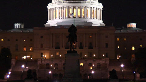Upward pan of the United States Capitol Building at night Footage