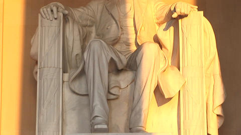 Golden light spills over a statue of President Lincoln Footage
