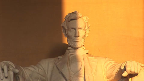 President Lincoln's sculpted face is seen half in shadow,... Stock Video Footage