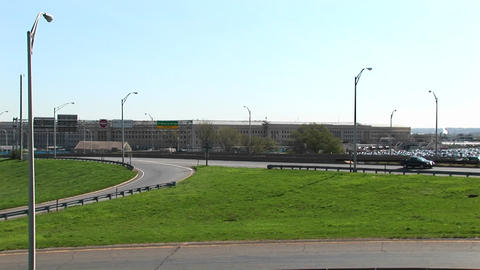 A view of the freeway near the Pentagon zooms-in to the Pentagon building Footage