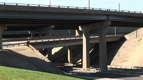 A pan shot of cars driving over a freeway overpass Stock Video Footage