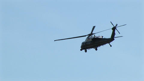 A military helicopter flies over Washington DC Live Action