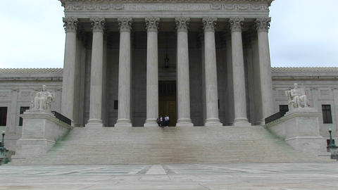A pan-up of the columned entrance to the Supreme Court Stock Video Footage