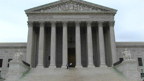 A pan-up of the columned entrance to the Supreme Court Footage