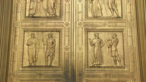 Close view of the historic figures carved into the bronze doors at the west entrance Supreme Court Live Action