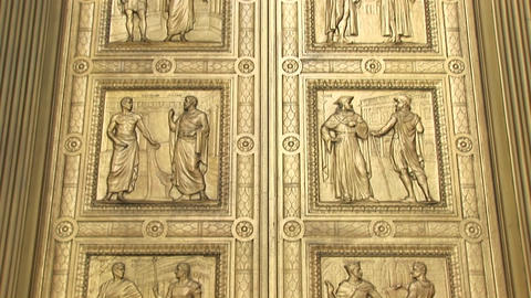 Close view of the historic figures carved into the bronze... Stock Video Footage