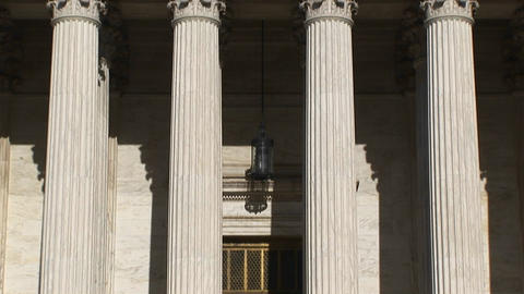 Sunlight reflects on the bright white pillars of the U.S. Supreme Court Building entrance Footage