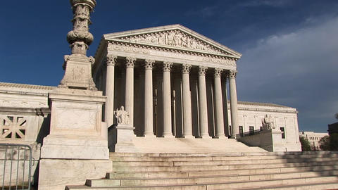 Sunlight reflects on the white stone steps and bright white pillars of the U.S. Supreme Court Buildi Footage