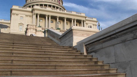 Looking up steps of the landmark U.S. Capitol building in... Stock Video Footage